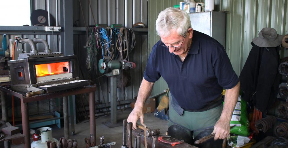 The Australian master farrier Carl O'Dwyer forging a horseshoe