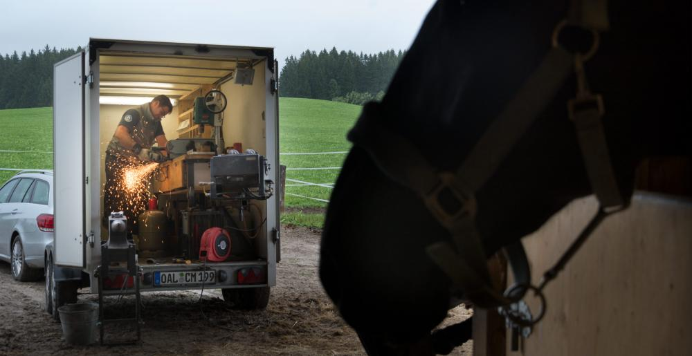 The German farrier Christoph Müller at work in his trailer