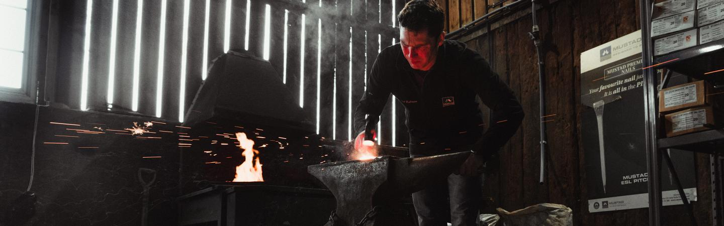 A farrier forging in his workshop